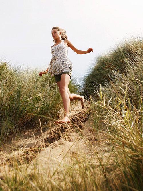 Girl running barefoot